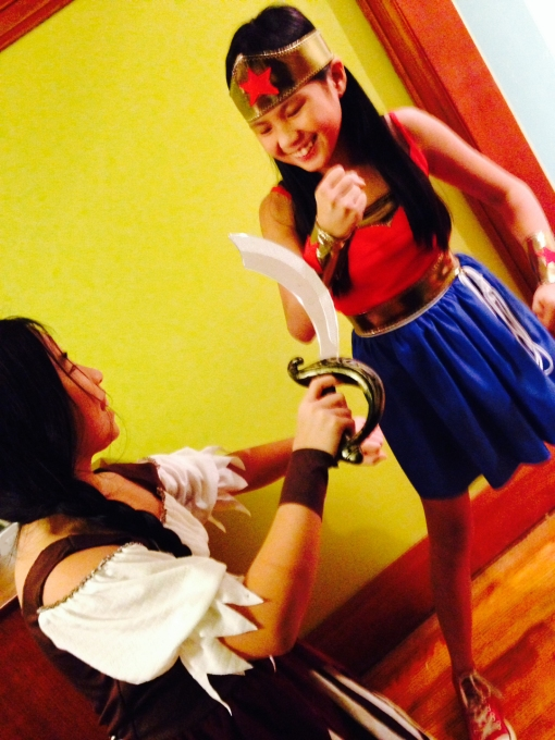 Two of my children, a.k.a. store-bought Pirate and handmade Wonder Woman, in a battle for costume supremacy